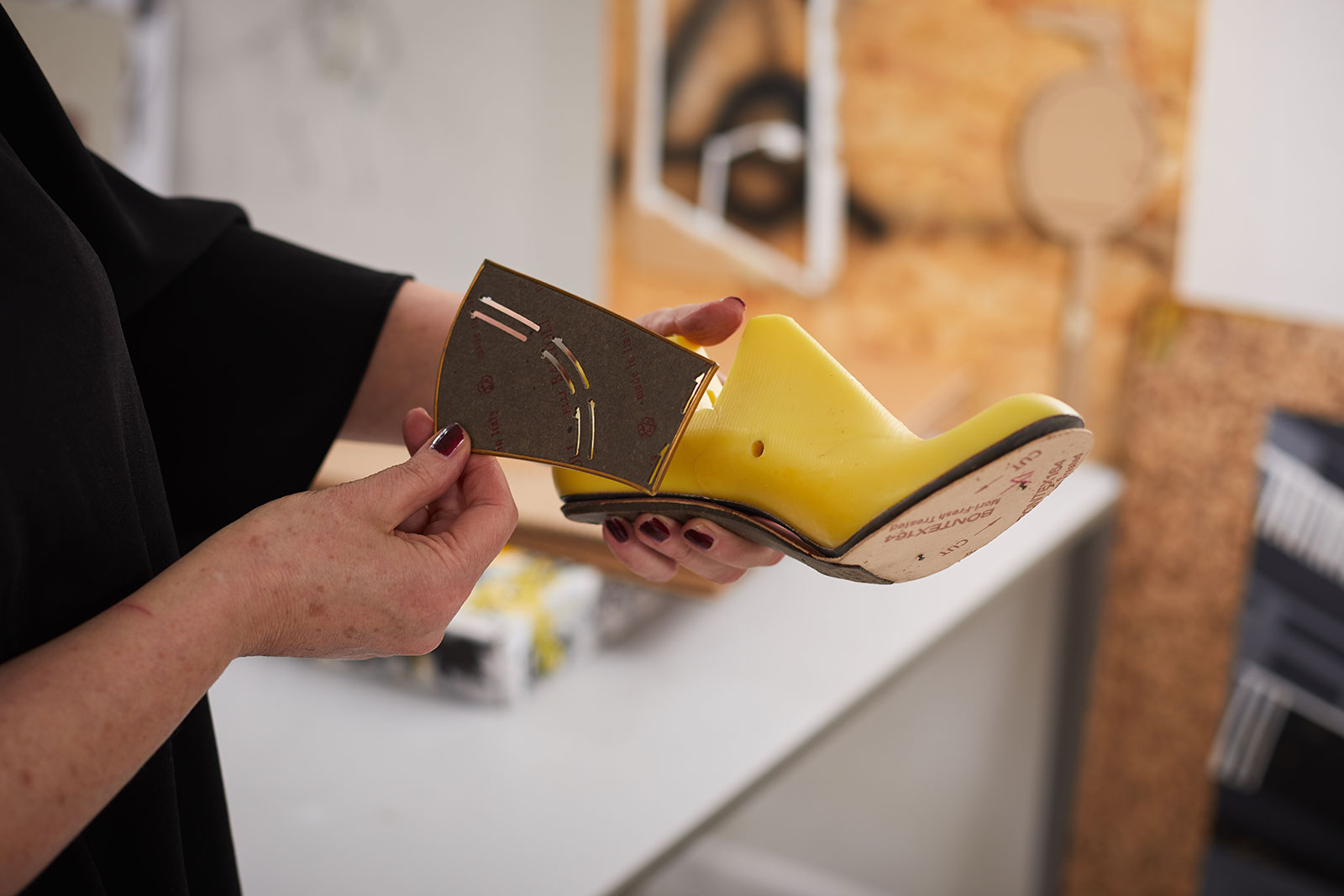 Marie Brennan, head of postgraduate courses at Norwich University of the Arts works on her shoemaking in the NUA Fine Art studio