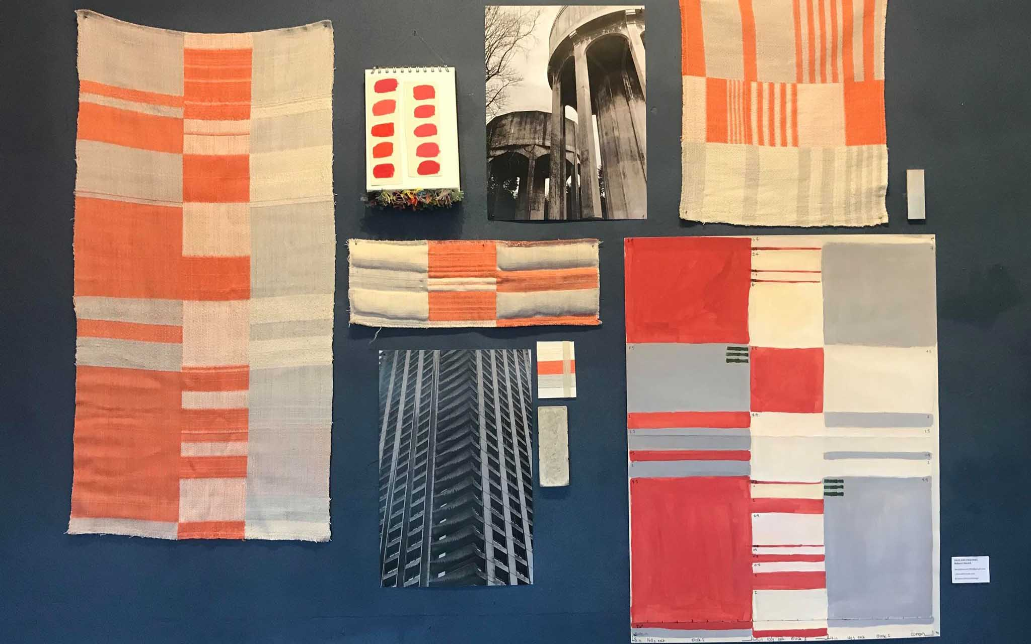 A variety of Rebecca Hiscock's orange coloured textile design work on a blue wall at the Norwich Playhouse