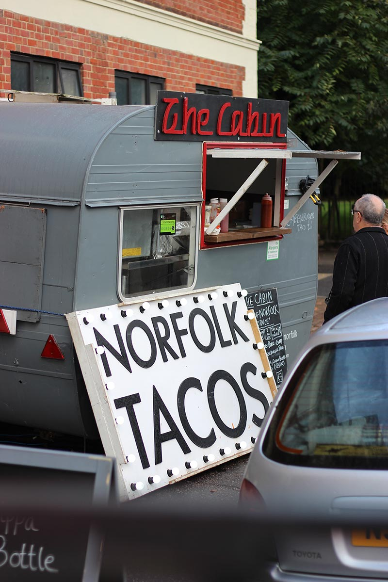A sign saying 'Norfolk Tacos' at the Cabin, a food truck at Wild Paths Festival, Norwich