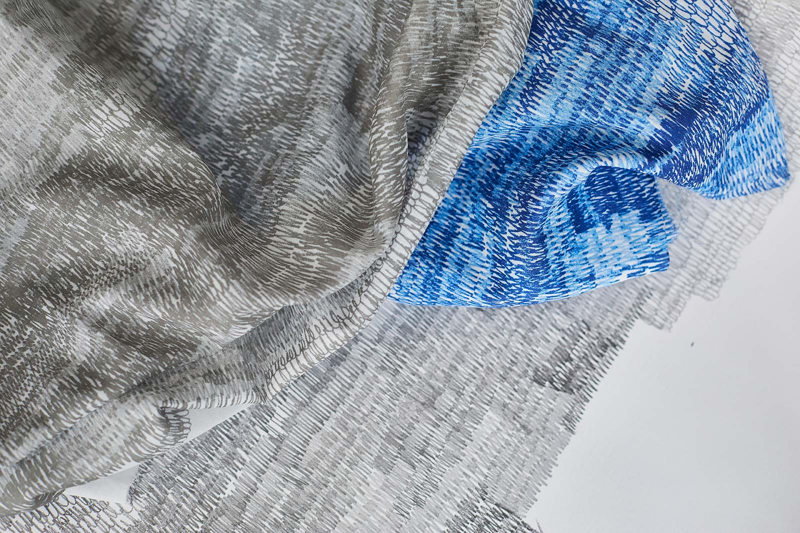 Cloth designs by BA Fashion and BA Textile Design Course Leader Kate Farley - showing blue and grey cloth