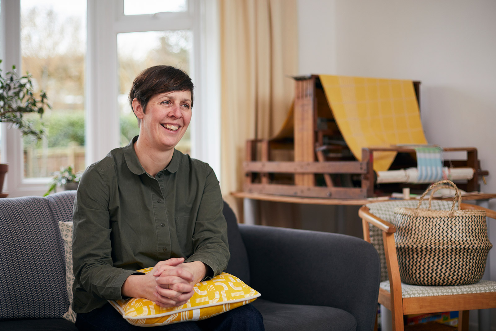 Kate Farley, Course Leader of BA Fashion and BA Textile Design sat in her home-studio in front of a loom