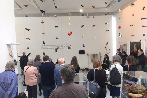 Sonic Flock - Exhibition space showing art work hanging from several strings on the ceiling by Lucy Robertson