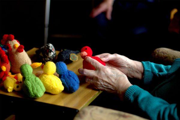 Sonic Flock - Lucy Robertson's textile work showing multi coloured ducks being held