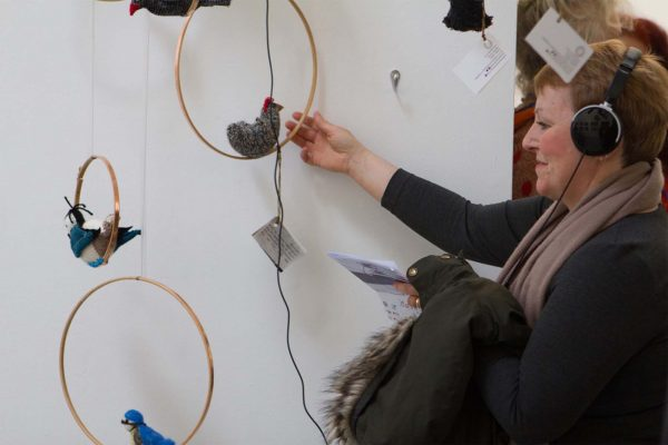 Sonic Flock - 'Flock' staff work by Lucy Robertson showing a woman holding a wheel