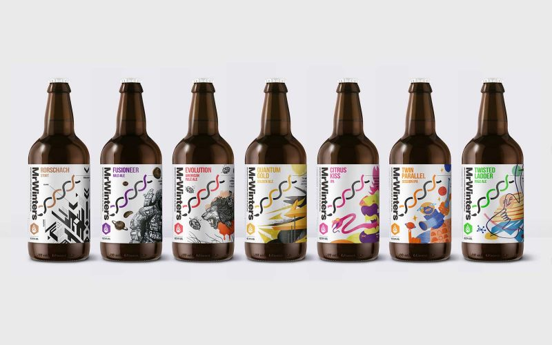 A lineup of beer bottles on a white background with vibrant illustrations
