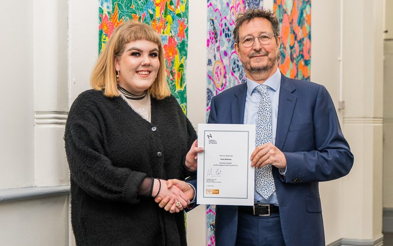 Graphic Communication student Kirsty McKinlay shakes hands with Professor John Last (Vice-Chancellor) on receiving the Nic Hughes Travel Prize 2019
