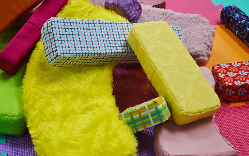 Lots of brightly coloured soft fabric shapes in various sizes a big pile