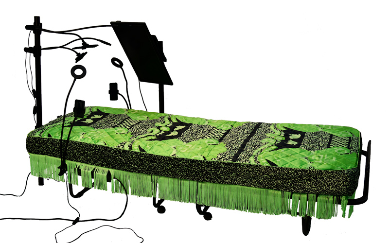 BA Illustration Graduate, Felicity Morris's final masters project. A green-screen mattress surrounded by blogger ring lights and a digital screen, which live streams to social media.
