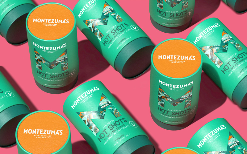 A flatlay of cylindrical hot chocolate Montezuma's packaging, designed by BA Graphic Design graduates Chris Murdoch and Andy Coy.