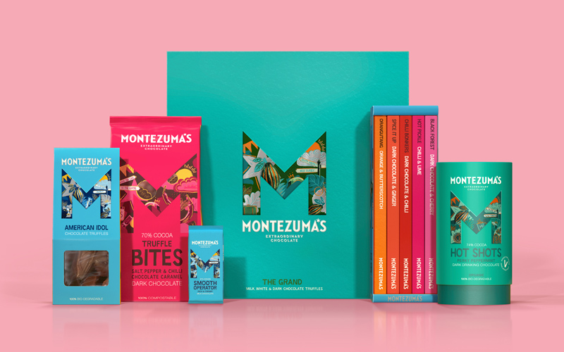 A lineup of Montezuma's chocolate packaging in various colours on a pale pink background. Each item of packaging features the design by BA Graphic Design graduates Chris Murdoch and Andy Coy