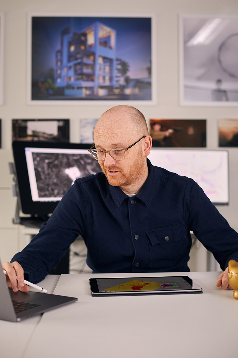 BA Animation Lecturer Jon Dunleavy sits in front of a computer, a cintix designing animations
