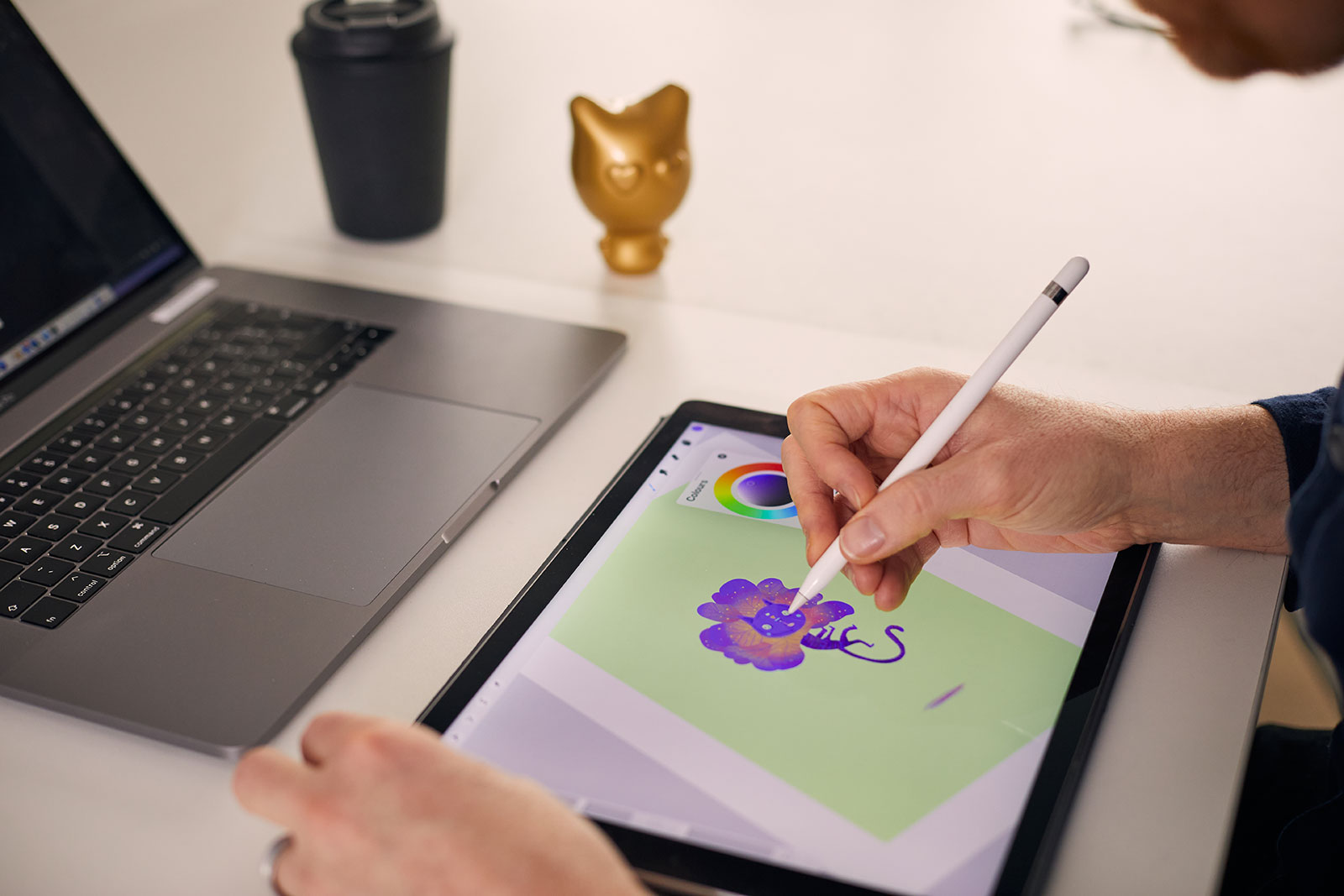 Jon Dunleavy BA Animation lecturer animates a bright character on an iPad