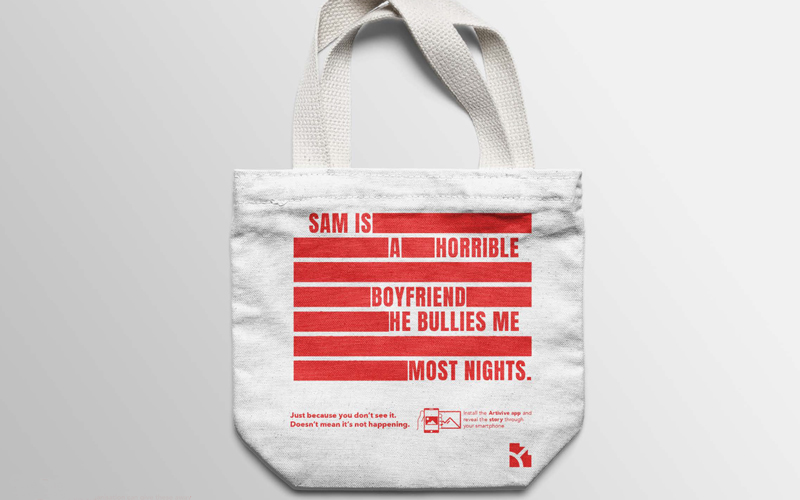 Drew Florence's winning entry into the Dragon Rogue Firestarter comeptition. A tote bag showing half of a typographic domestic abuse story