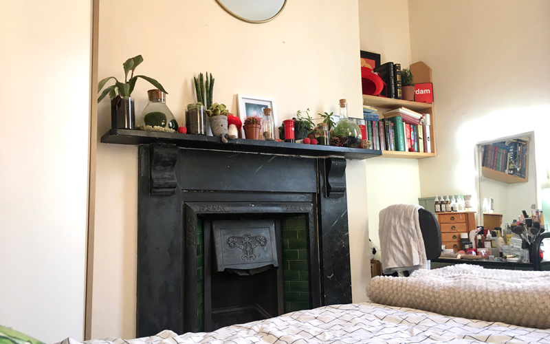My Student Home: a look inside a bedroom with a black fireplace in a terraced house.