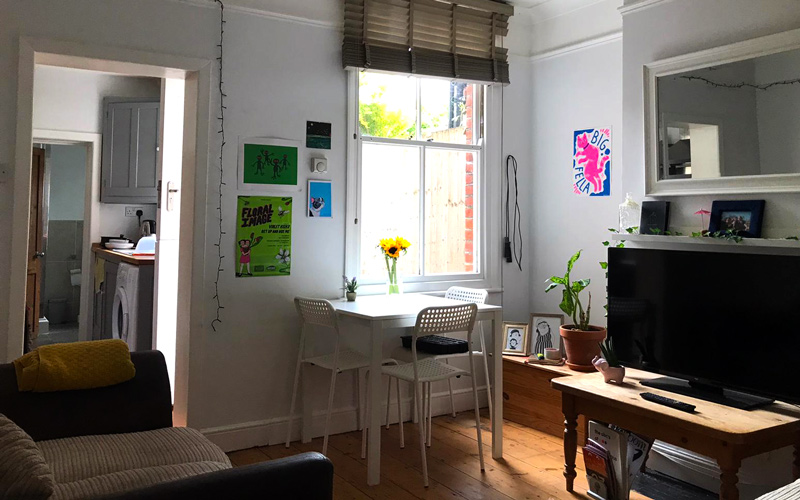 My Student Home: Inside BA Illustration student Patricia Mercer-David's private rented home in Norwich. The living room is spacious and airy, with various illustrated prints on the walls
