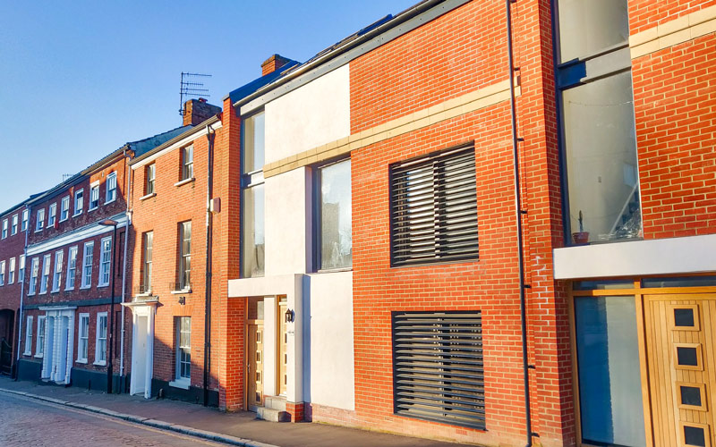 My Student Home: outside Twins Ethan and Molly Brown's modern terraced home in the city centre. The house has a modern, sleek exterior with large windows