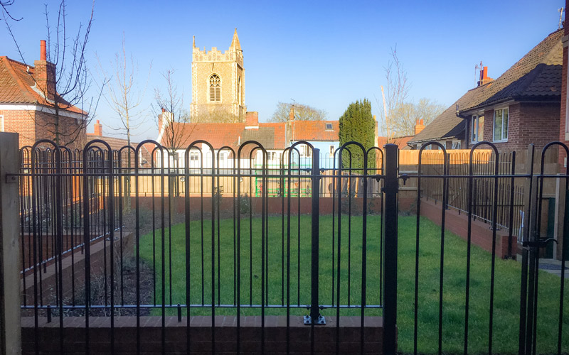 My Student Home: a look at twins Ethan and Molly Brown's back garden. There is a metal gated area filled with green grass with plenty of space to socialise