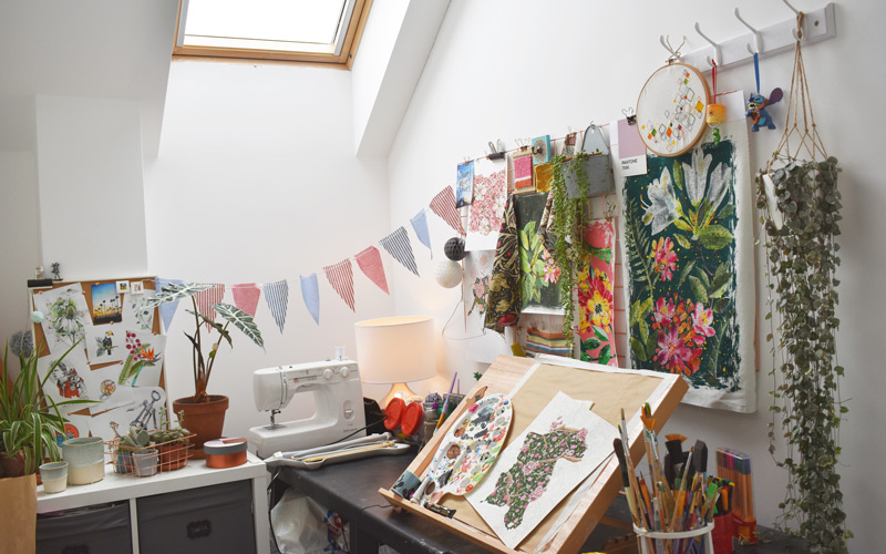 My Student Home: a look at twins Ethan and Molly Brown's terraced home in the city centre. In Molly's bedroom, there is a sectioned off area that she uses as a personal textiles studio. There is a skylight window over tables covered in hand-drawn surface patterns, bunting, painting tools and embroidered artworks by Molly.