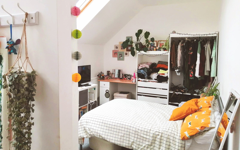My Student Home: a look at twins Ethan and Molly Brown's terraced home in the city centre. Molly's room is painted white, with a double bed, lots of desk and storage space. It is decorated with fairy lights and plants. Above Molly's bed is a sloping ceiling with a skylight window.