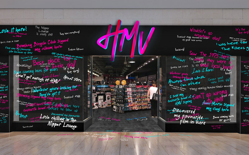 BA (Hons) Graphic Design students Ryan Hayes, Jess Edwards and Tyler Pearce's winning design for YCN New Now competition to rebrand HMV. A visual of HMV's store front, featuring a neon pink hand-drawn HMV logo. The store windows and floor are covered in neon pink, white and blue testimonials from customers, all in a hand-drawn style