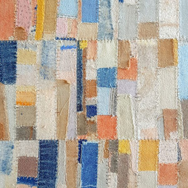 Lucie Summers - Square artwork in blues, yellows, oranges and creams made up of different sized square and rectangular pieces of fabric