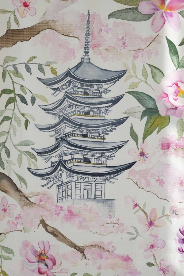 Daisy Gyapong - Close up of a printed piece of silk showing a Japanese tiered building surrounded by green leaves and pink flowers