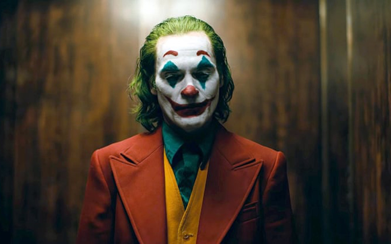Still from film Joker showing a man dressed as the joker