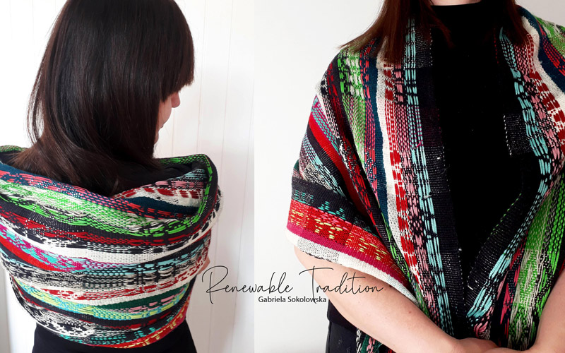 Award-winning project by BA Textile Design graduate Gabriela Sokolowska. A brunette woman wears a shawl inspired by traditional Polish costume. The shawl is woven with white, black, green, pink and red yarns