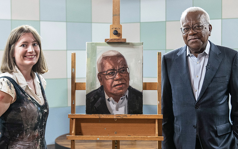 Francesca Currie stood with Trevor McDonald