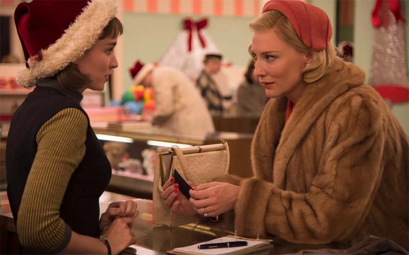 Still from film Carol showing two women talking at a counter