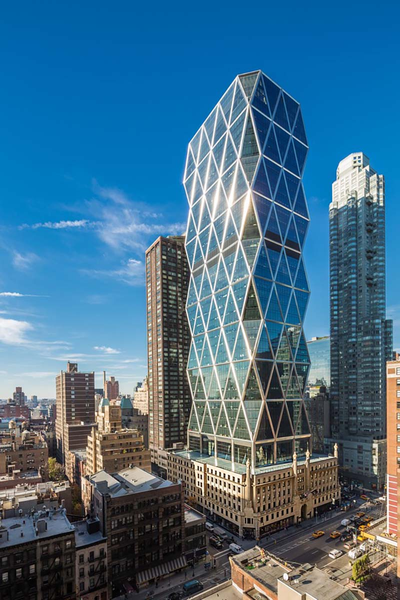 A photo of The Hearst Tower in New York City, New York. The building is designed in a diagrid form, and fronted completely with panes of glass.
