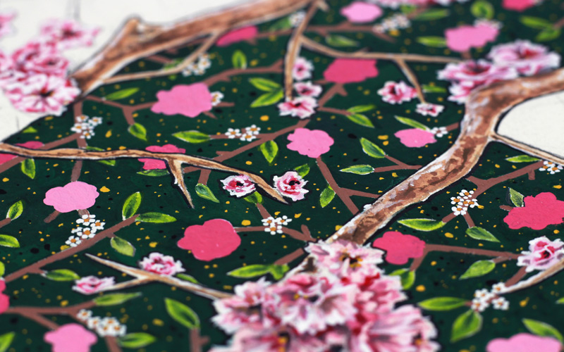 A close up shot of a hand-painted floral surface pattern by BA Textile Design graduate Molly Brown. A green painted background with shades of pink flowers on brown branches intertwine across the painting
