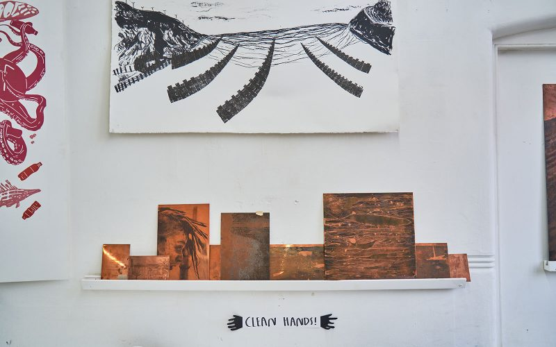 Blocks of wood below a print in a workshop
