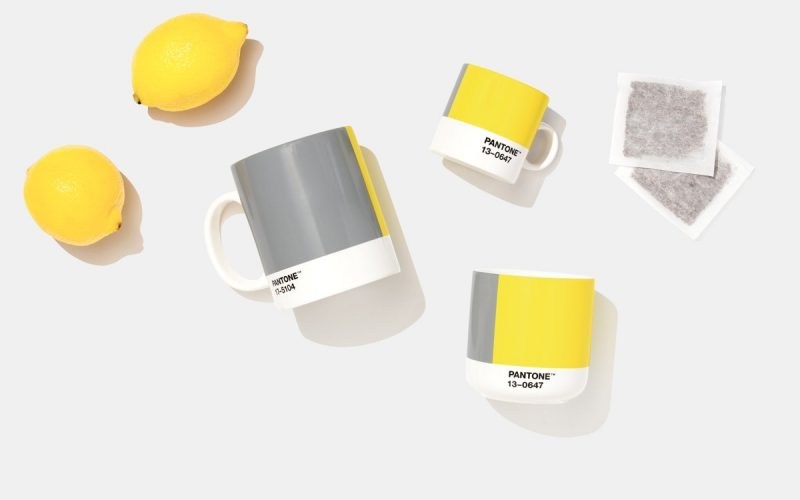 Flat lay image of grey and yellow items as part of Pantone Colour of the Year 2021