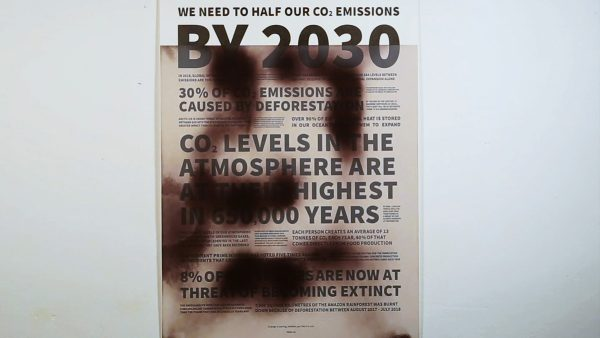 Chloe Turner - Poster design about Co2 emissions by Chloe Turner, BA Graphic Communication. A typographic poster, partially obscured by a black smoke-like patch. Made using hydrothermic ink that dissolves when heated