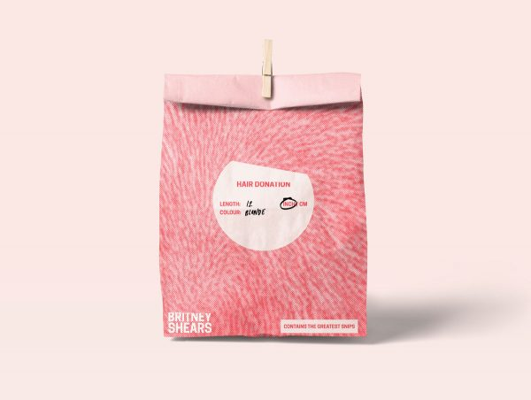 Kirsty McKinlay - A mockup of a pink paper bag with the 'Britney Shears' branding by BA Graphic Communication student Kirsty McKinlay