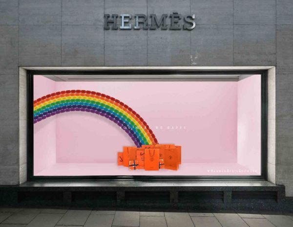 Beth Poulter - Store window visual merchandising for Hermes, featuring a pink backdrop with a rainbow. At the bottom of the rainbow are Hermes bags. By BA Fashion Communication and Promotion student Beth Poulter