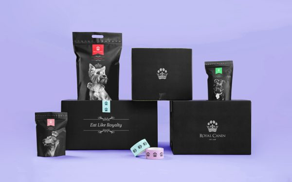 Tom Hardwick - A mockup of Royal Canin pet food packaging, including postal boxes with a crown in the shape of a paw, pet food sachets, and tape with a paw print pattern. By BA Graphic Design graduate Tom Hardwick