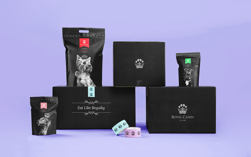 A mockup of Royal Canin pet food packaging, including postal boxes with a crown in the shape of a paw, pet food sachets, and tape with a paw print pattern. By BA Graphic Design graduate Tom Hardwick