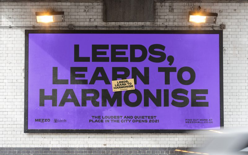 Billboard campaign design by BA Graphic Communication student Ben Sanderson. A purple billboard with black text saying 'Leeds, learn to harmonise' - promoting a local music venue
