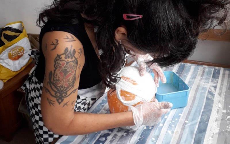 BA Fine Art student Natasha Day working at a desk
