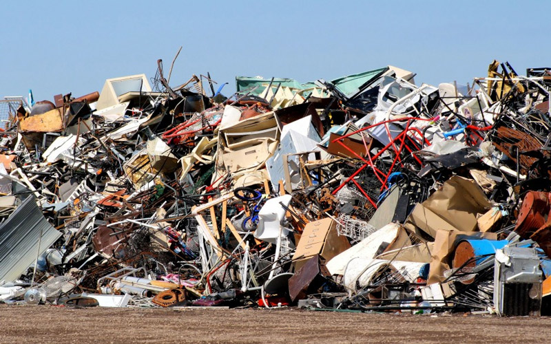 A large mound of waste made up from disposed 'fast' furniture