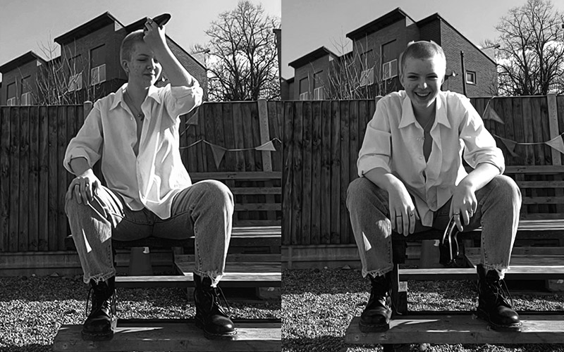 two black and white images next to each other. person sitting on bench in both. First picture shaving off hair and second image is the person smiling