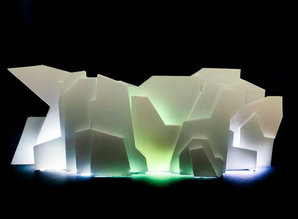Jose Peralta - 3D structure made out of origami/geometric shapes, with areas lit white and green