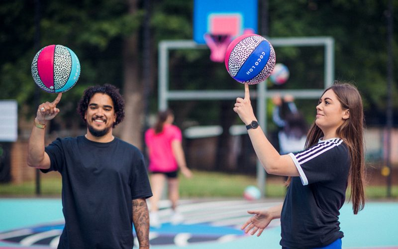 Photo of Gareth Roberts and Coco Lom spinning basketballs on their finger